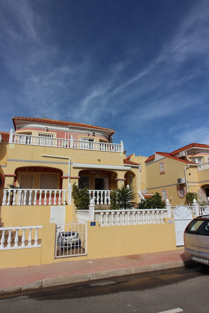 Beautifully presented two bedroom end of terrace townhouse in Villamartin, which has been extensive, Spain